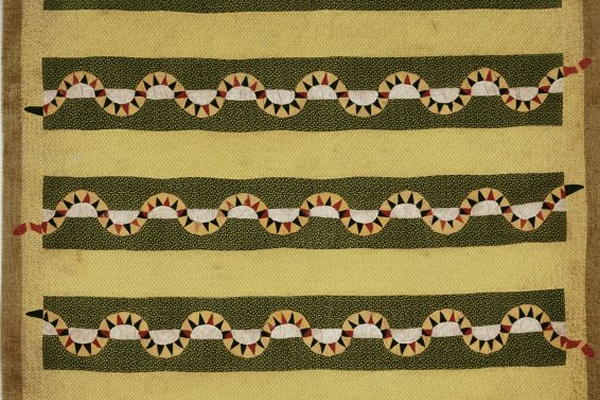 Quilted bedcover in yellow and olive green featuring long snakes in horizontal bands.